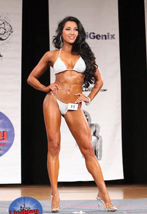 Pro female bodybuilder poses and shows off her physique - 5 5